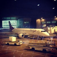 Photo taken at Concourse J by Ivens  L. on 1/11/2013