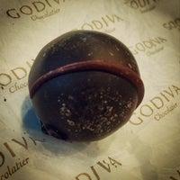 Photo taken at Godiva Chocolatier by Dmitry C. on 9/18/2014