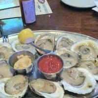 Photo taken at Biggie's Restaurant Raw Bar Tavern by Krisha H. on 10/14/2012