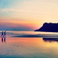 Photo taken at Praia de Guaecá by Thomaz M. on 12/26/2012