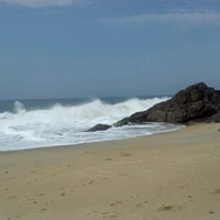Photo taken at Praia de Boiçucanga by Carolina S. on 10/27/2012