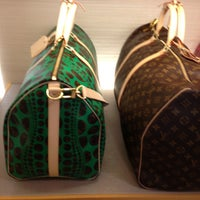 Photo taken at Louis Vuitton by Valery C. on 12/29/2012