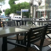 Photo taken at Tomas Morato Avenue by Vic M. on 7/2/2013