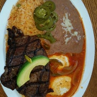 Photo taken at Rodeo Mexican Grill by Ricardo C. on 7/15/2014