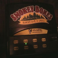 Photo taken at Smokey Bones Bar & Fire Grill by Andrew P. on 5/20/2012