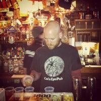 Photo taken at Cat's Eye Pub by Jerel V. on 3/22/2012