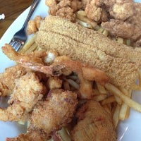 Photo taken at Boudreaux's Cajun Kitchen by Allen A. on 8/12/2012