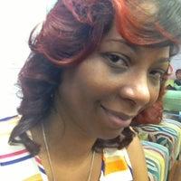 Photo taken at Coils Hair Lounge by Rhonda B. on 4/19/2013