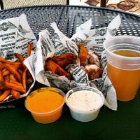 Photo taken at Wingstop by Howard C. on 2/15/2015