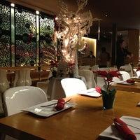 Photo taken at Osha Thai Restaurant by Liz P. on 12/16/2012