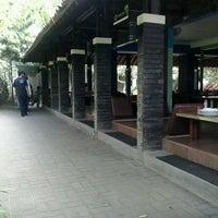 Photo taken at Taman Santap Rumah Kayu by Indah M. on 5/10/2013