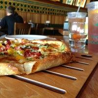 Photo taken at La Grande Orange Grocery & Pizzeria by Heather F. on 7/4/2013