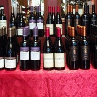 Photo taken at Vinously Speaking - An Eclectic Wine Shop & Blog by Vinously Speaking W. on 12/15/2012