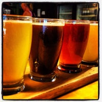 Photo taken at Holy City Brewing by Nicholas C. on 6/19/2013