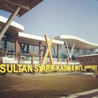 Photo taken at Sultan Syarif Kasim II International Airport (PKU) by Faradilla A. on 7/24/2013