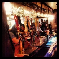 Photo taken at Quips Pub by C W. on 3/10/2013