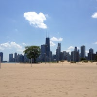 Photo taken at North Avenue Beach by Ari N. on 6/20/2012