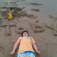 Photo taken at Sandy Bay Beach by Chris M. on 8/16/2012
