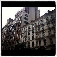 Photo taken at W 52nd St by Meghan R. on 7/28/2012