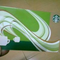 Photo taken at Starbucks by Sorasak I. on 12/24/2011