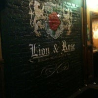 Photo taken at The Lion & Rose British Restaurant & Pub by Zeke S. on 3/18/2012