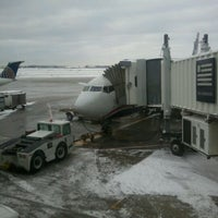 Photo taken at Gate F10 by Kelsey L. on 1/21/2012