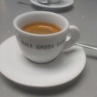 Photo taken at Kala Ghoda Café by K C. on 9/6/2012