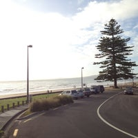 Photo taken at Mairangi Bay Beach by Marty K. on 3/30/2012
