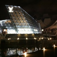 Photo taken at Louis Vuitton Island Maison by Shane Y. on 4/21/2012