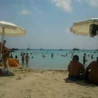 Photo taken at Konnos Beach by Maria E. on 6/24/2012