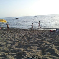 Photo taken at Spiaggia allo Scoglio by Carmelo M. on 7/15/2012