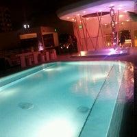 Photo taken at Highbar - Pool·Bar·Sky by Enrique N. on 11/19/2011