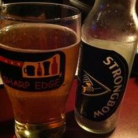 Photo taken at Sharp Edge Beer Emporium by Marguerite M. on 6/24/2011