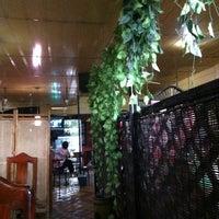 Photo taken at Afhy Tea Milk & Food by Peerasak C. on 3/8/2012