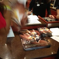 Photo taken at Bow Tie Cinemas Warner Quad by Liz T. on 4/16/2012