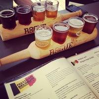 Photo taken at Tyler's Restaurant & Taproom by Blake H. on 7/21/2012