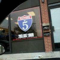 Photo taken at Tattooz On 5 by Wanda T. on 2/2/2012