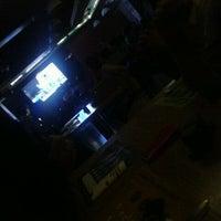 Photo taken at V Spot Bar + Cafe by Gejo J. on 3/30/2012