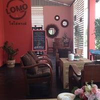 Photo taken at Lomo Cafe'' by Powder P. on 3/2/2012