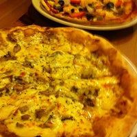 Photo taken at Puzzini Swedish Pizza by Pamela Y. on 6/13/2012