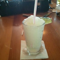 Photo taken at Hooters by Tina on 3/13/2012