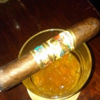 Photo taken at Highland Cigar Co. by Phil O. on 7/28/2012