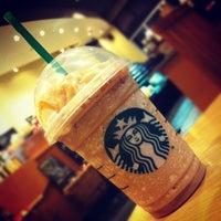 Photo taken at Starbucks by [t] m. on 11/10/2011