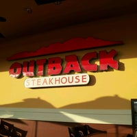 Photo taken at Outback Steakhouse by Guilherme A. on 1/8/2012