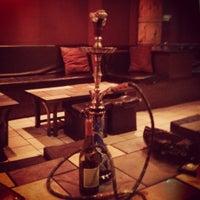 Photo taken at Arabian Nights Hookah Bar and Lounge by Correy on 8/3/2012