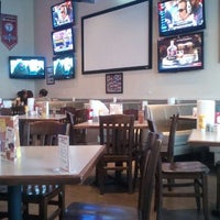 Photo taken at Pluckers Wing Bar by Marquis D. on 1/9/2012