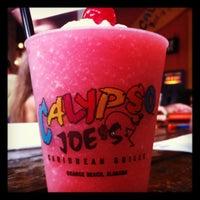 Photo taken at Calypso Joe's Caribbean Grille by Jeremy S. on 8/5/2012