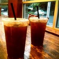 Photo taken at Zoka Coffee Roaster & Tea Company by Kate K. on 7/18/2012