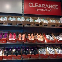 Photo taken at Nike Factory Store by Catherine L. on 2/16/2012