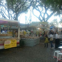 Photo taken at Feira Noturna do Champagnat by Andre D. on 11/4/2011